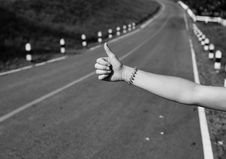 Free Hitchhiking Hand Sign Stock Images - 110655004
