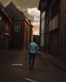 Free Man Walking Alone In The Street Of Town Stock Photos - 110655023