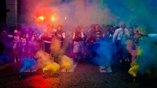 Free Group Of People On Road With Assorted-color Smokes Stock Images - 110655024