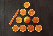 Free Sliced Orange Fruit With Knife Stock Photography - 110655092