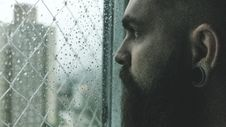 Free Selective Focus Photography Of Man Staring On Glass Window Filled With Droplets Royalty Free Stock Image - 110655176