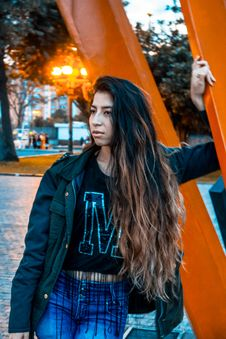 Free Woman Wearing Black Jacket Leaning On Orange Metal Stock Images - 110655244