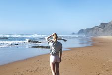 Free Woman In Gray Long-sleeved Shirt With Pink Short Shorts Standing Near Sea Stock Image - 110655261
