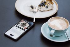 Free Black Smartphone Beside Coffee Mug In Shallow Focus Lens Royalty Free Stock Photos - 110720948