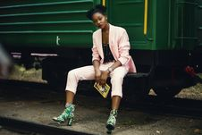 Free Woman In Pink Blazer Sitting On Green Train Royalty Free Stock Photo - 110720965