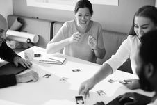 Free Grayscale Photography Of Four Person Having A Discussion Royalty Free Stock Photo - 110720975
