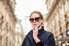Free Woman Wearing Black Coat And Brown Framed Sunglasses Stock Image - 110721001