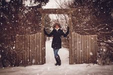 Free Woman In Black Coat Beside Fence During Snow Stock Image - 110796321