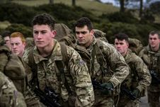 Free Group Of Military Carrying Rifles Royalty Free Stock Photos - 110796338
