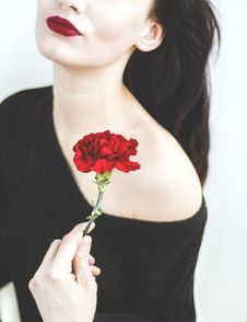 Free Woman In Black One-shoulder Top Holding Red Carnation Royalty Free Stock Photo - 110796365