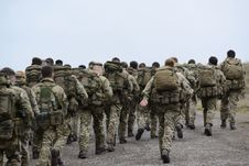 Free Group Of Army Walking Stock Photos - 110796393