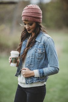Free Woman Wearing Blue Denim Jacket And Pink Knit Cap Holding Starbucks Coffee Stock Photos - 110796413