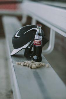 Free Coca-cola Bottle Beside Black Easton Batting Helmet Stock Images - 110796464