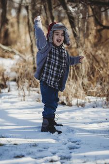 Free Boy In Gray Jacket And Blue Jeans Standing On Snow Outdoor Royalty Free Stock Photography - 110885587