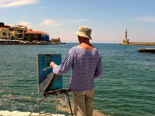 Free Man In White And Blue Striped Long-sleeved Shirt Painting Near Seashore Stock Images - 110885594