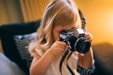 Free Shallow Focus Photography Of Girl Holding A Black And Silver Dslr Camera Stock Photography - 110983952