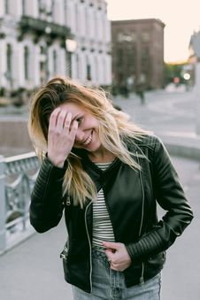 Free Photo Of Woman Wearing Black Zip-up Leather Jacket And White And Black Striped Shirt Stock Image - 110983981