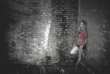 Free Woman Wearing Orange Crew-neck Short-sleeved Shirt Leaning On Concrete Wall Stock Image - 110984011