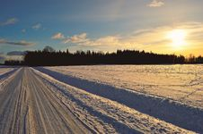 Free Snow Covered Road During Golden Hour Stock Photos - 110984013