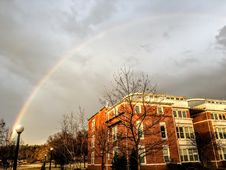 Free Rainbow Appear Above Brown And White Concrete Building Royalty Free Stock Image - 110984016