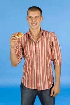 Free Man With Burger Royalty Free Stock Image - 1110786