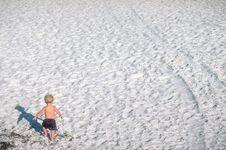 Small Boy Walking On Beach Stock Image