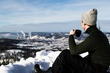 Free Man Wearing Jacket And Holding Cup Sitting On The Snow Royalty Free Stock Photos - 111070068