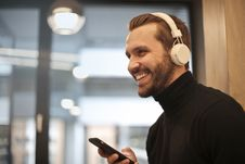 Free Man Wearing White Headphones Listening To Music Royalty Free Stock Photography - 111070077