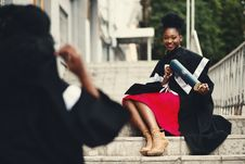 Free Woman Wearing Black Graduation Coat Sits On Stairs Royalty Free Stock Photo - 111070085