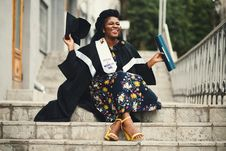 Free Photo Of Woman Wearing Academic Dress And Floral Dress Sitting On Stairway Royalty Free Stock Photos - 111070088
