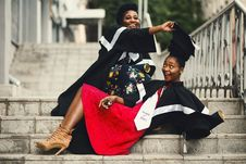 Free Shallow Focus Photography Of Two Women In Academic Dress On Flight Of Stairs Stock Photos - 111070093