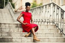 Free Woman In Red Off-shoulder Dress With Brown Leather High Heeled Gladiator Sandals On Brown Stairs Royalty Free Stock Photography - 111070097