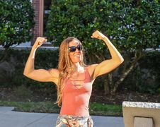 Free Woman In Pink Tank Top Showing Her Biceps Stock Image - 111070201