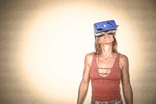 Free Woman In Brown Cages Sleeveless Top And Blue Virtual Reality Headset Royalty Free Stock Photos - 111070208