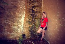 Free Woman Wearing Red Crew-neck Sleeved Shirt And Blue Denim Short Shorts Royalty Free Stock Photos - 111070248