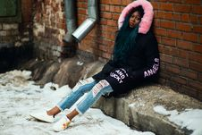Free Woman Wearing Black And Pink Parka Leaning On Brown Brick Wall Royalty Free Stock Photos - 111070258
