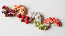 Free Assorted Sliced Fruit Lot On White Surface Royalty Free Stock Photo - 111070315