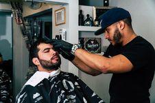 Free Man Wearing Black Shirt Trimming The Hair Of Man Stock Photography - 111169922