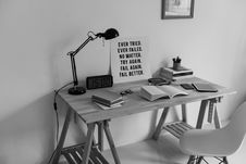 Free Grayscale Photography Of Desk With Books And Table Lamp Royalty Free Stock Photography - 111170057