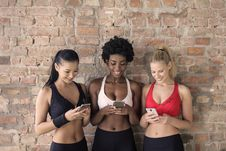 Free Three Woman In Assorted-color Sport Bras Holding And Watching Their Smartphones Royalty Free Stock Photography - 111170117