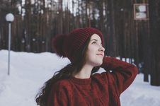 Free Woman Wearing Maroon Bobble Beanie On Winter Day Stock Photos - 111170143