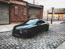 Free Black Audi A-series Parked Near Brown Brick House Royalty Free Stock Photography - 111170367