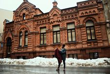 Free Man Holding Red Coat Standing On Street Near Brown Building Stock Images - 111217254