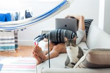 Free Woman Lying On Sofa With Cat In Her Foot Stock Photos - 111217293