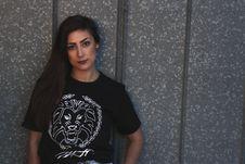 Free Woman Wearing Tiger Head-printed Crew-neck Shirt Stock Image - 111277621