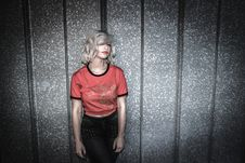 Free Woman Wearing Red And Black Scoop-neck Shirt And Black Bottoms Leaning On Gray Wall Royalty Free Stock Photo - 111277625