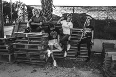 Free Grayscale Photo Of Four Women On Wooden Pallets Stock Photo - 111277640