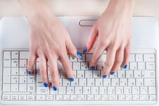 Free Female Hands Typing On White Laptop Keyboard Stock Photography - 111352852