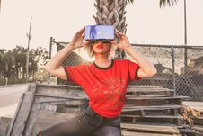 Free Woman In Red Crew-neck T-shirt Wearing Virtual Reality Glasses Stock Image - 111364511