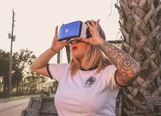 Free Photo Of A Woman Using Virtual Reality Glasses Stock Photo - 111364540